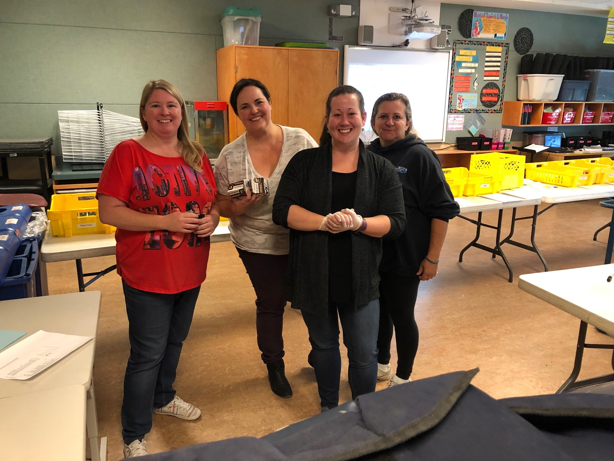 Just a few of our amazing volunteers who help out with pizza day each week. We are so grateful for your support!